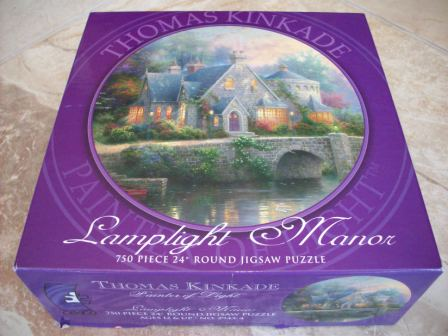 "Thomas Kinkade 750 Piece Puzzle - ""Lamplight Manor"""